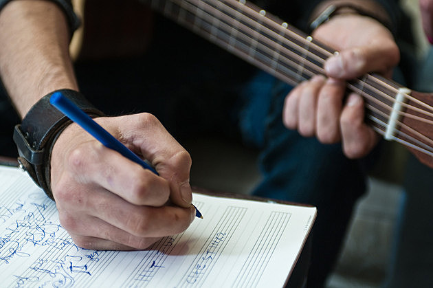 Songwriter writing song