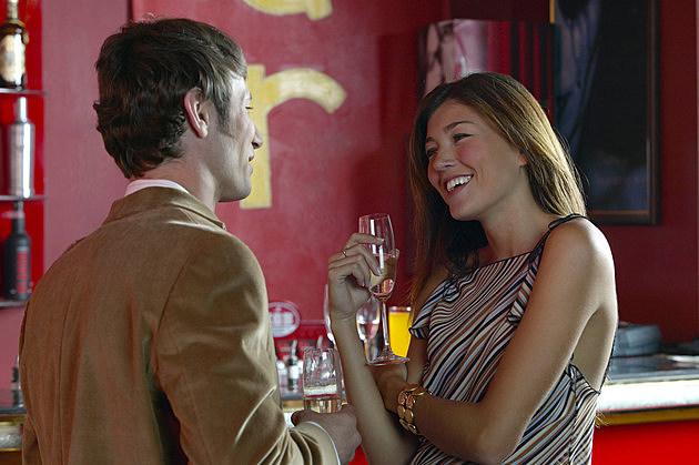 Young Couple Talking at a Bar