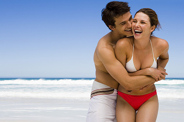 Couple laughing at beach